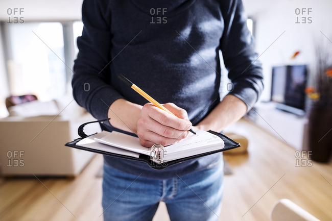 Man writing into his personal planer