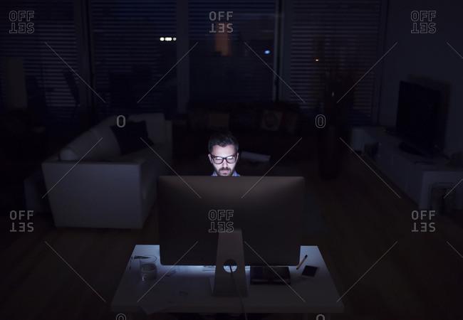 Man working at night using computer