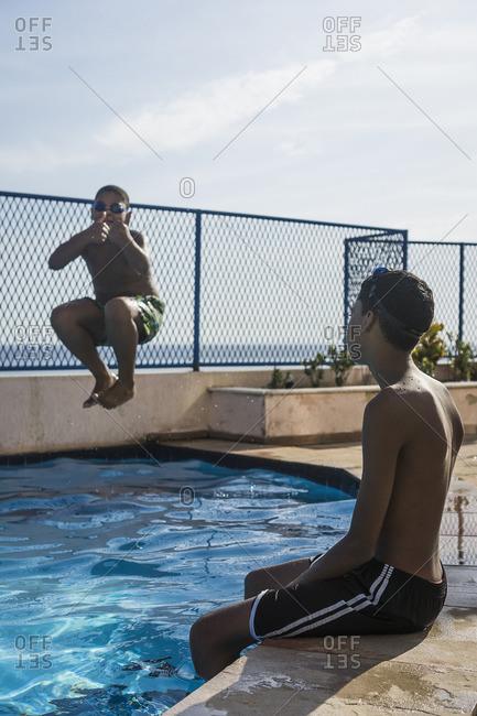 Two boys having fun in swimming pool