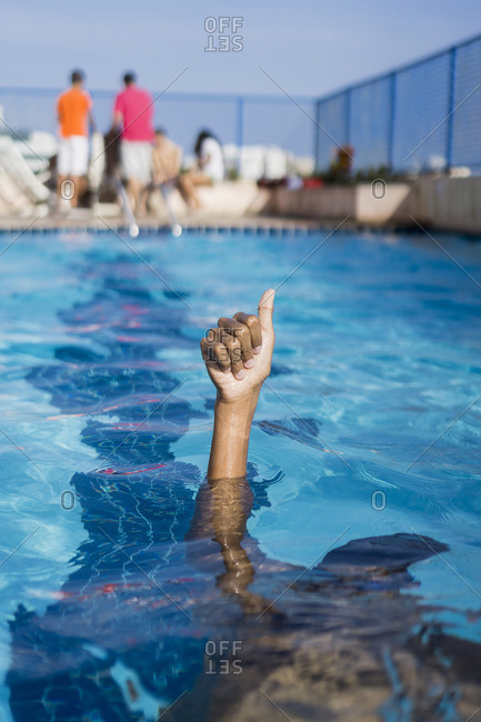 Hand of a boy inside swimming pool