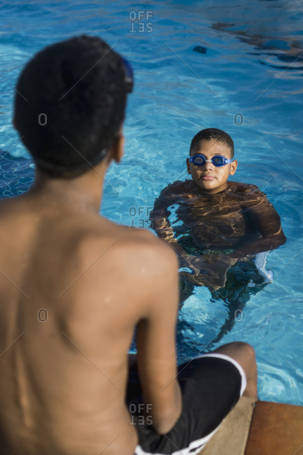 Two boys in swimming pool