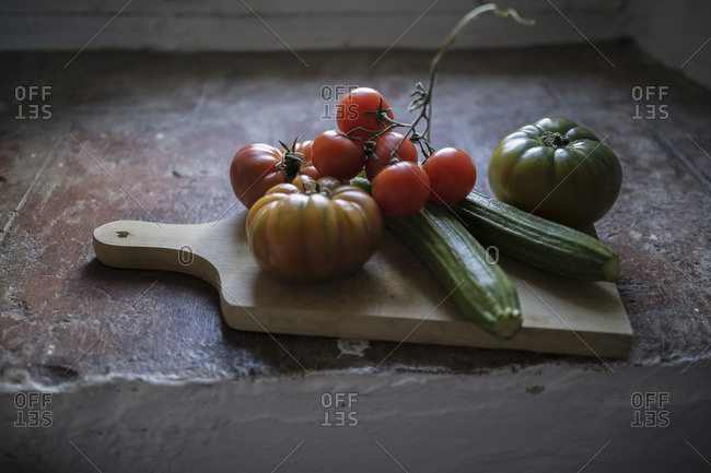 Tomatoes and courgette on windowsill