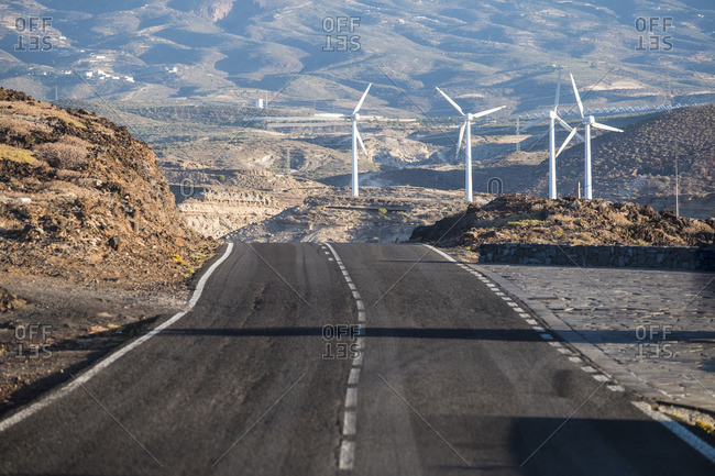 Empty road and wind park
