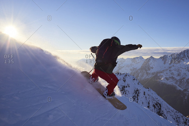 Snowboarder riding down a slope