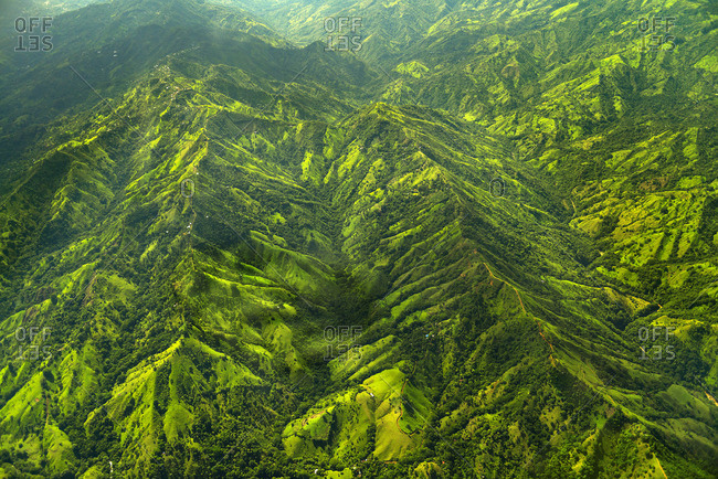 Aerial view of parallel ridges of green mountains