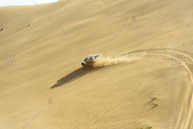 Oman - October 7, 2013: Car driving through desert