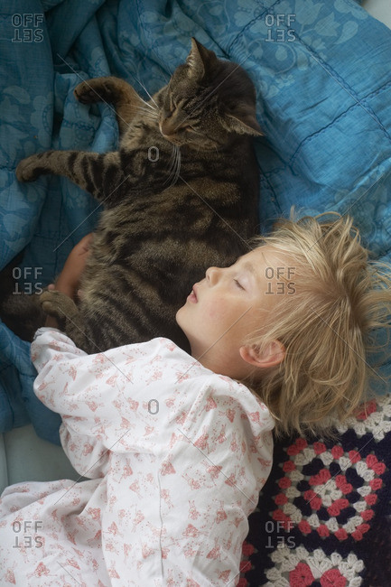 Girl sleeping with cat