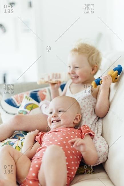 Happy children on sofa