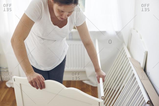 Woman assembling crib
