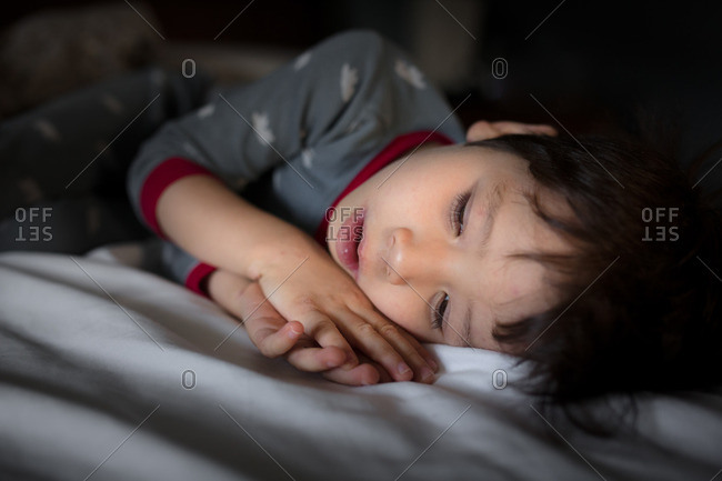 Boy in pajamas lying down