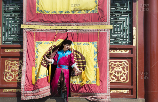 Summer Palace guide coming out of performing pavilion in Beijing, China