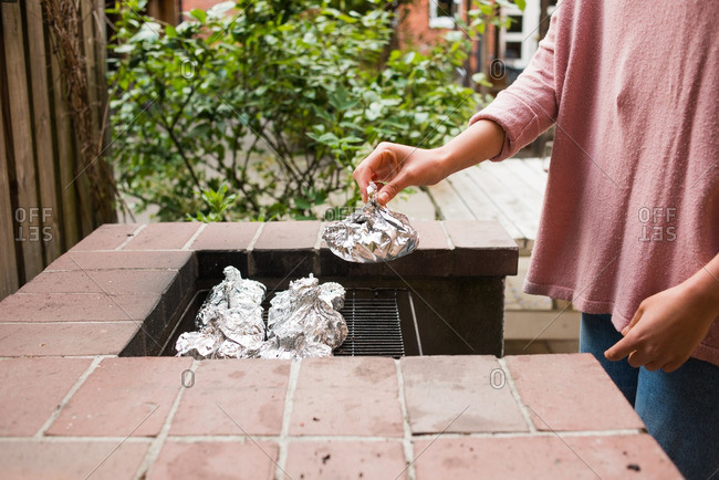 Person placing food on grill