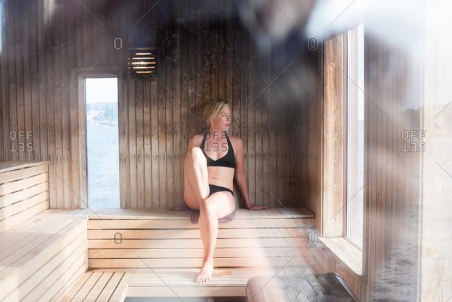 Woman inside of a sauna
