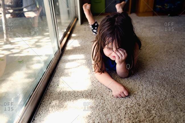 Girl lying on floor laughing