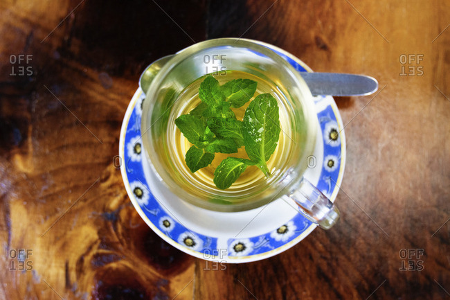 Overhead view of herbal tea served on wooden table