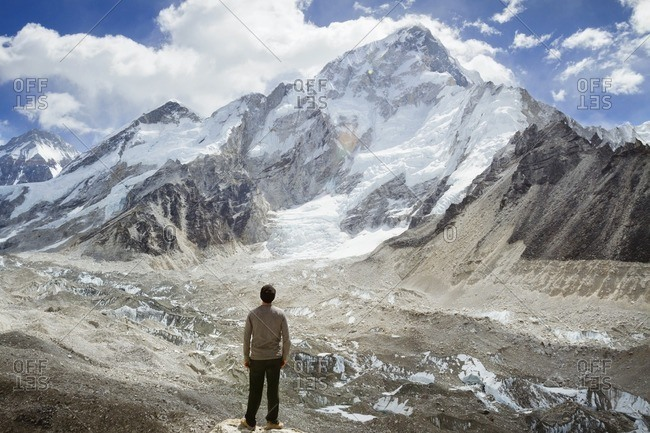 Rear view of man looking at Mt. Everest during winter