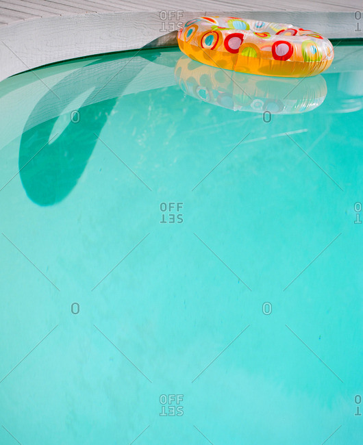 Colorful inflatable ring floating in a pool