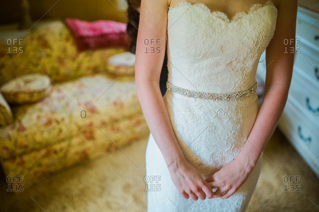 Close up of bride wearing lacey wedding gown