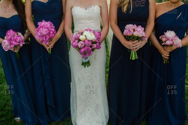 Bride and bridesmaids at an outdoor wedding