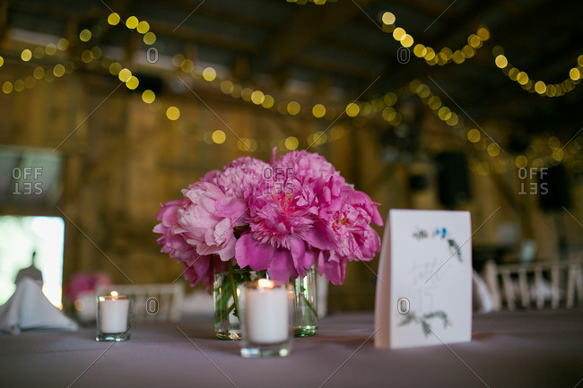 Centerpiece on a table inside a barn wedding