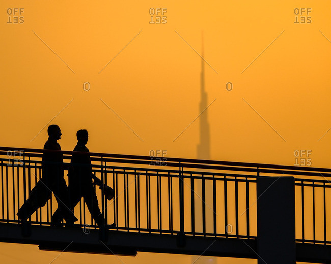 People walking at sunset, Dubai