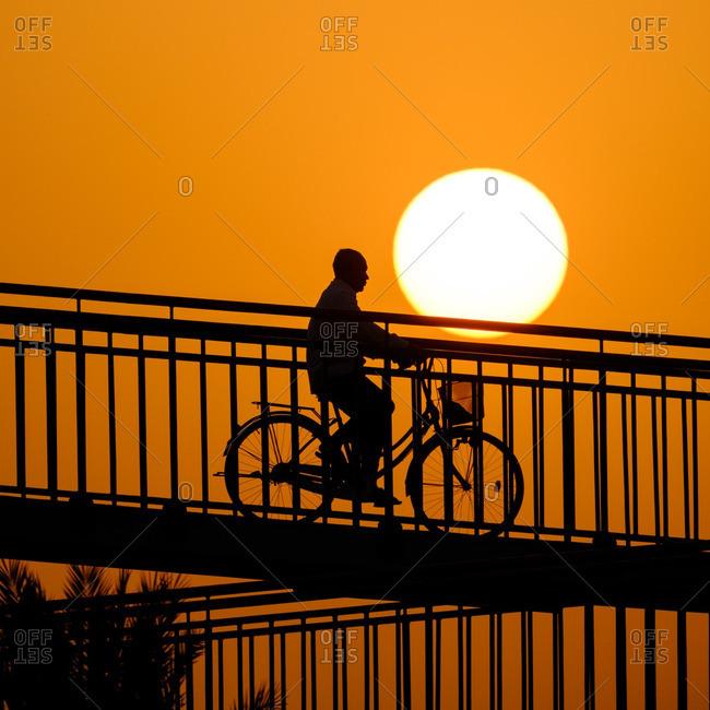 Person on bike in Dubai sunset