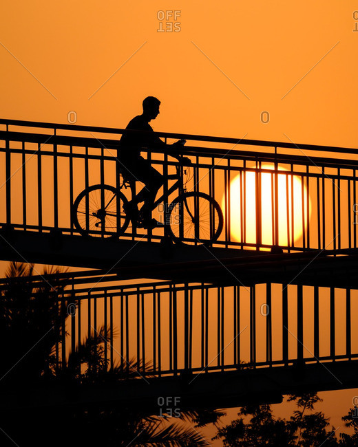 Person on a bike in Dubai sunset