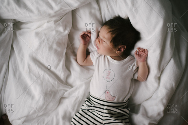 A baby sprawled on bed