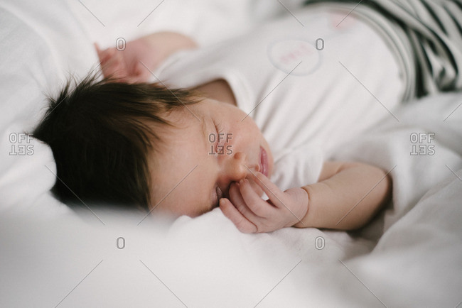 Baby sleeping peacefully on bed