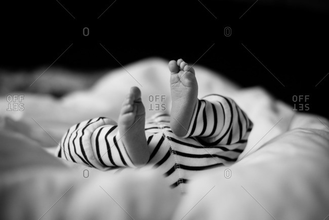 Feet of baby in striped pants