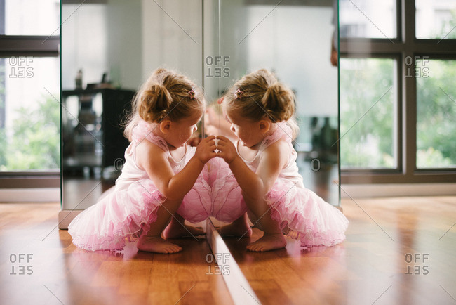 Girl in tutu at ballet mirror
