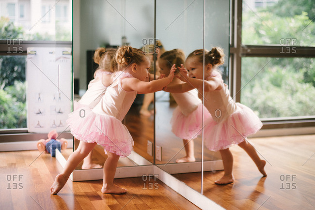 Girl at mirror in ballet dress