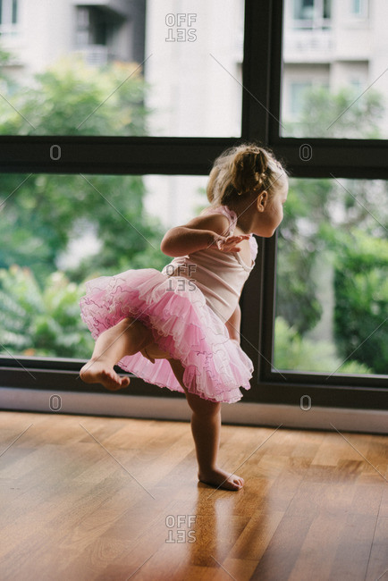 Girl in tutu on one leg