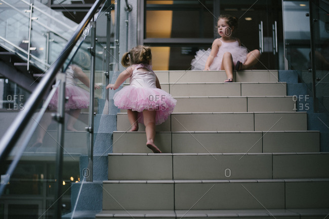 Girls on stairs in ballet outfits