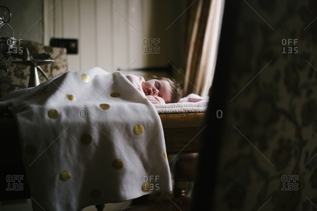 Infant napping on table