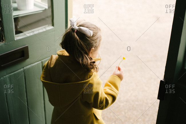 A girl on coat in doorway