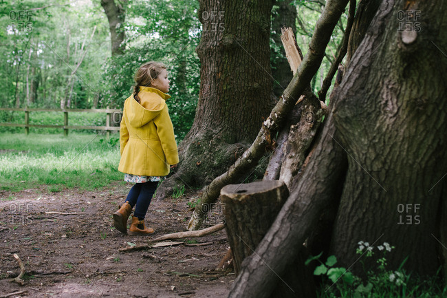 Girl in coat in wooded setting