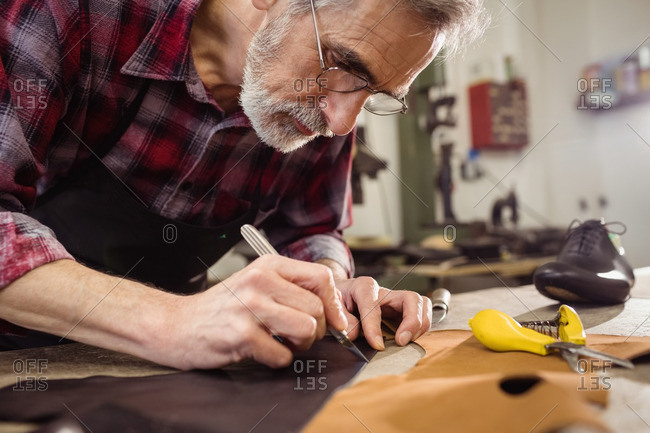 Close up of concentrated cobbler working with a blade