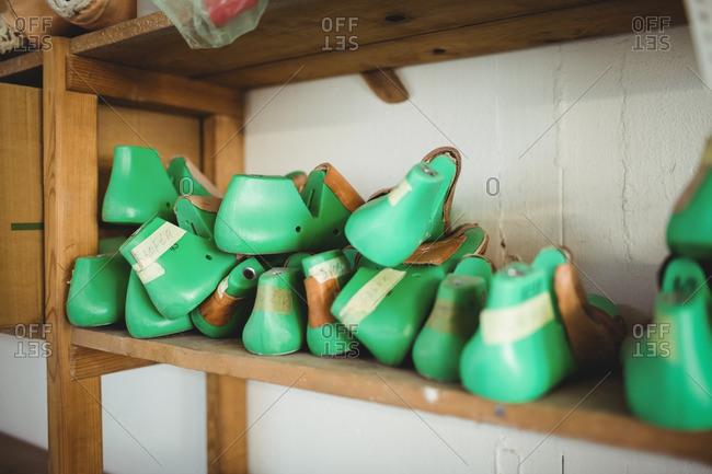 Tools of cobbler on a shelf in a workshop