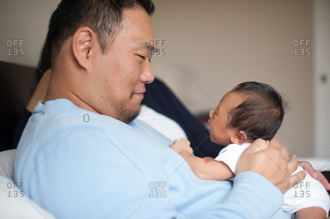 Father gazing at newborn baby