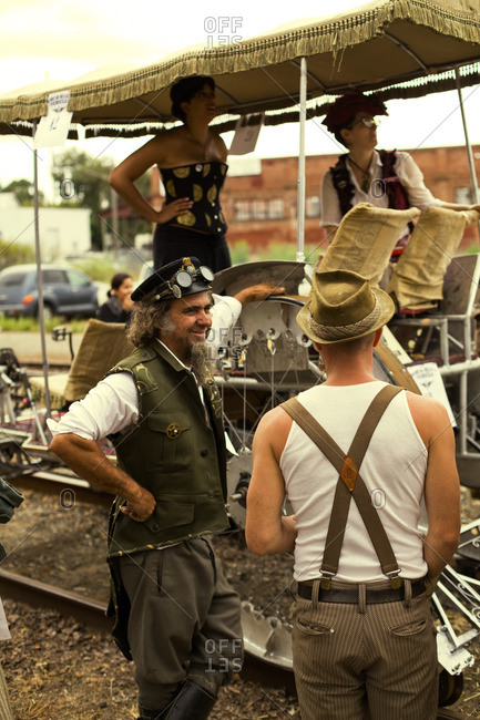 Santa Rosa, California - September 24, 2011: Participants stand in from of a steampunk vehicle on display in Santa Rosa, California