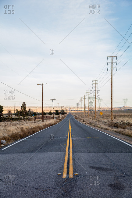 Power lines along an empty road in the Mojave Desert outside