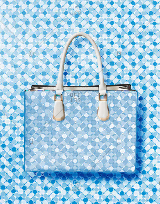 Handbag with blue dots on a matching background