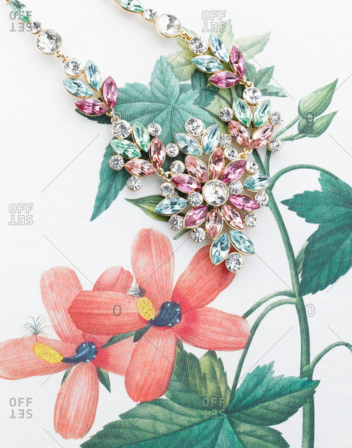 Chunky flower necklace on floral fabric