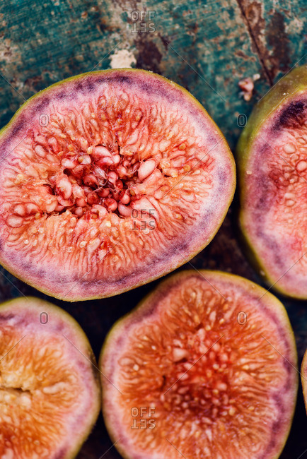 Cross-section of fig halves on a wooden surface