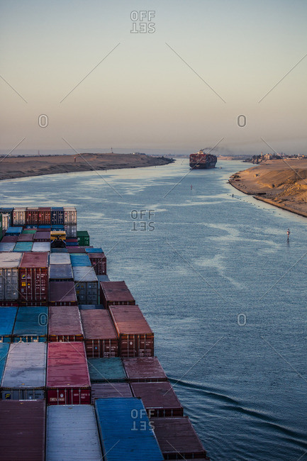 Suez, Egypt - April 8, 2014: A container ship passing through Suez Canal in the early morning