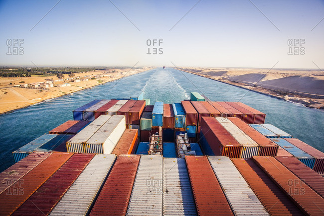 Suez, Egypt - April 8, 2014: Container ship passing through the Suez Canal in the morning