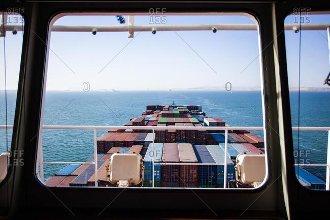 Suez, Egypt - April 8, 2014: Container ship passing through the Bitter sea in the middle of the Suez Canal