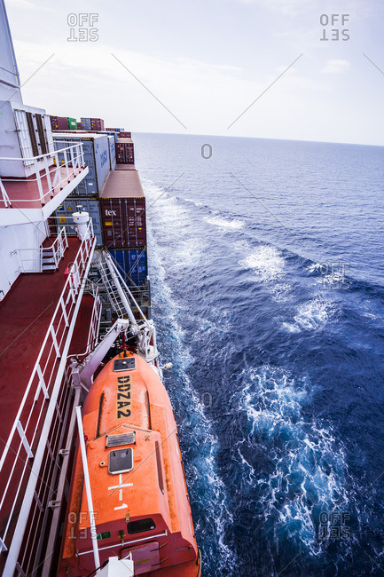 Red Sea - April 9, 2014: Life boat and container ship in the Red Sea