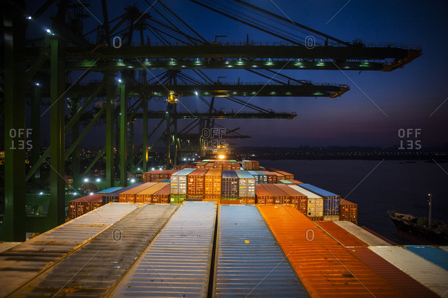 Singapore, Asia - April 25, 2014: Port of Singapore at night, seen from onboard a container ship